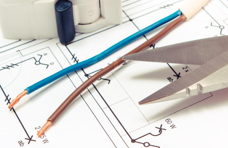 Cable cutter, electric cable and fuse on construction drawing of house, accessories for engineer jobs