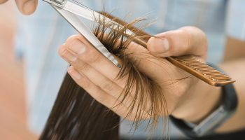 hairdresser-cutting-woman-s-hair-in-salon-focus-on-hair-hands-and-scissors-close-up-78119917-57f6a5a55f9b586c3535c1b6