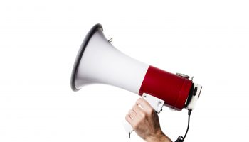 isolated-portrait-of-a-hand-holding-a-megaphone-KLF52YT